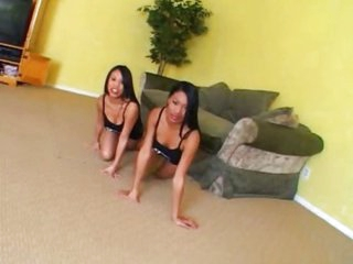 2 Oriental sisters share a big strapon