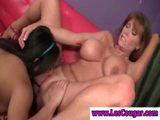 Two busty lesbians get jointly with cougar Darla Crane eating twat
