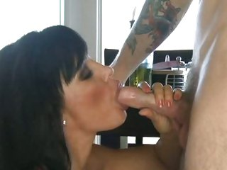 Lisa Ann gets on her knees to mouth a concupiscent cock