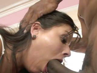 Filthy brunette hair chokes on a massive dark fuck shaft