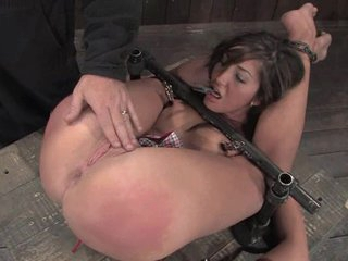 The slut was bound down as her slit was poked with fingers and toys