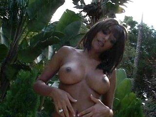 Super slut Rita G masturbating on her warm twat outdoors