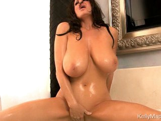 Luscious Kelly Madison can't live without teasing her moist clitoris