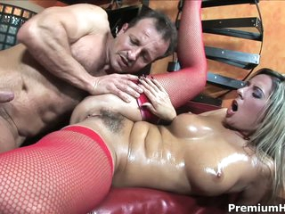 Daria Glower is a sexy as hell european mllf. She wears red mesh stockings in this video. Stacked blonde Daria Glower give head and then man fucks her hairy pussy like mad.