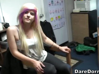 Girls and guys kill time playing soccer in the dorm room. Girl with blonde and pink hair has fun with latino boy and her roommate. Watch them kick ball and score!