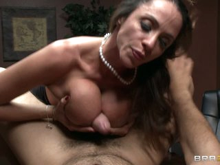 Big breasted brunette milf Ariella Ferrera lures Ramon into fucking her mouth and big breasts. She gives head and takes his prick between her gigantic tits at the office.