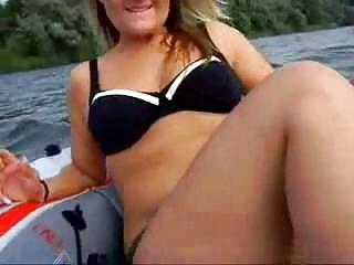 Amateur blonde masturbating on boat