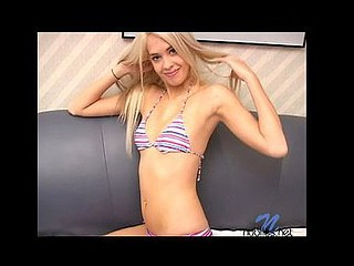 Barenaked lindie starts to put cream on her firm body