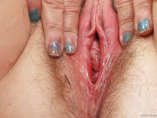horny granny putting a dildo in her pussy.