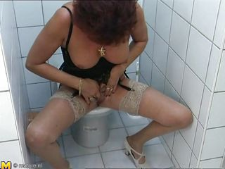 old woman fingering herself in a bathroom