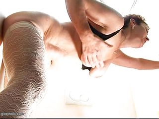 mature enjoying a bbc from the glory hole