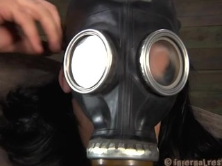 Nice looking bitch in the gas mask is getting her punished
