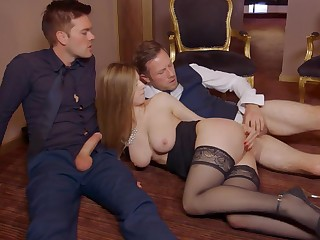 A girl with huge tits is taking care of two guys in the lead same time