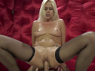 A bimbo with a hot round ass and a shaved pussy is getting fucked hard