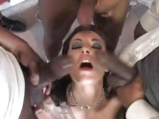 White chocolate chick with tattoo plays with black weenies in gang bang