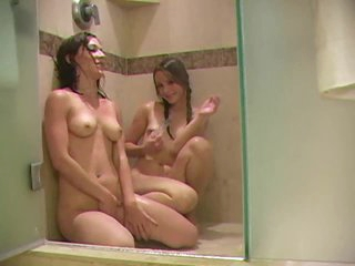 Juicy young chicks in shower toy