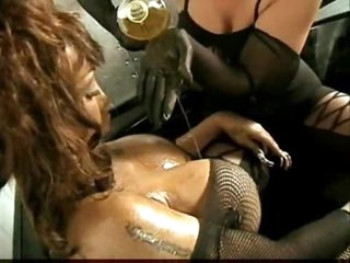 Girls pour oil on each other lustily